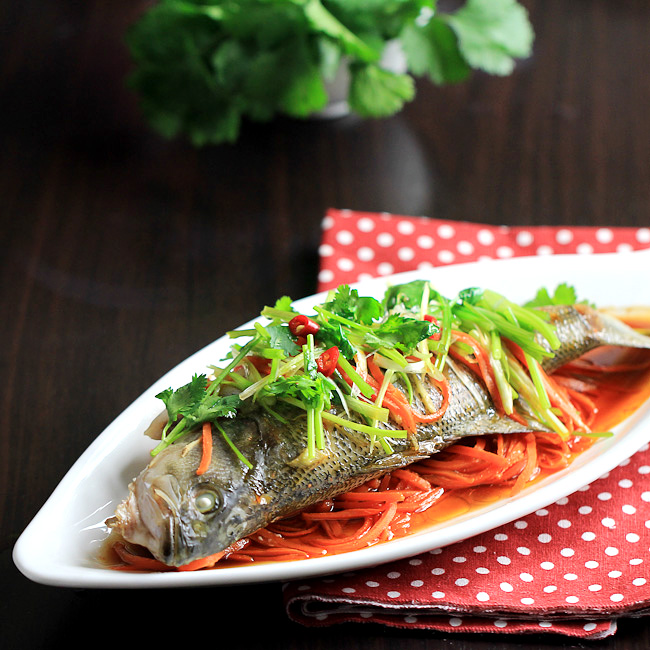 Traditional and authentic Chinese steamed fish with soy sauce.